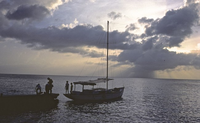 Then:  Sunset at Cabanas del Caribe, with our dive boat at the dock